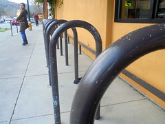 DSC01710 (classroomcamera) Tags: outside outdoors walk walks walking woman women follow follows following bike rack racks bicycle metal bar barsyellow sidewalk sidewalks