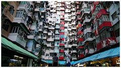Crowded apartment buildings through the lens (Alice 2018) Tags: sonysel1670zcarlzeissvariotessart carlziess zeiss sony sonyilce6000 sonya6000 a6000 ilce6000 1670mmf4 window hongkong 2017 woman lady girl people architecture asia building color quarrybay apartment housing aatvl01 aatvl02
