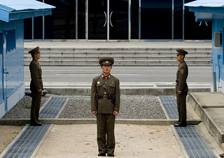 North Korean soldiers standing in front of the United Nations conference rooms on the demarcation line in the Demilitarized Zone, North Hwanghae Province, Panmunjom, North Korea