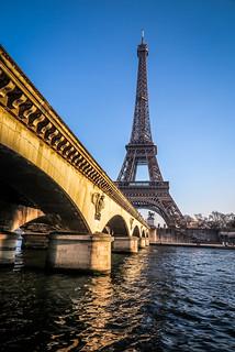 The Eiffel Tower against a blue winter sky, seem from across the River Seine, along the length of Point de D'Iena, Paris, France