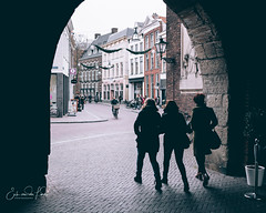 The arch (erikvdlinden) Tags: female afternoon walking streetphotography threepeople winter friend colorimage colourimage zwolle overijssel nederland nl