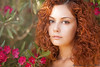 Portrait with flowers (Alessandro Guidi 1985) Tags: red alessandroguidifotografo photo photography model girl young woman teen teenager closeup makeup face eyes mouth lips natural beauty beautiful amazing hair long redhead curly