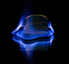 Blue Flame (Laurie4593) Tags: flame macromondays isopropylalcohol macro blue blueflame reflection mirror rock blackbackground canonrebelt3i sigma70mmf28exdgmacro