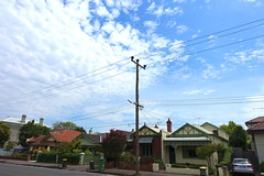 Older style telegraph pole with Brown multi layered insulators. (brandonquatro) Tags: leafy leafyinnercity suburbia melbourne victoria cliftonhill telegraphpole