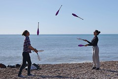 Juggling on Brighton Beach.... (markwilkins64) Tags: ruleofthirds juggling clubs brighton beach brightonbeach sea seaside peebles circusskills calm restful rhythm catching throwing man woman skilful talented canon sussex uk concentration focus timing