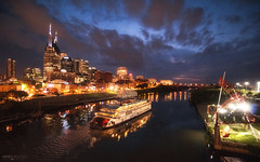 Cumberland River - Nashville (Tennessee) (Andrea Moscato) Tags: andreamoscato america statiuniti usa unitedstates us cielo clouds city città cityscape sky skyscraper skyline nuvole shadow sunset ombre luci light tramonto evening notte notturno night nightlife dark downtown darkness fiume river reflection riflesso perspective building edificio water freshwater acqua parco park panorama ponte bridge view vivid vista overlook blue red yellow boat battello