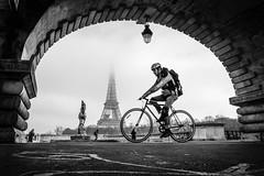 Eiffel (Mustafa Selcuk) Tags: winter streetphotographer streetphotography street foggy fog france paris cyclist bicycle velib velo parisien parisian fujifilmfrance fujifilmtr fujifilm monochromatic monochrome blackandwhite bw bnw 16mm 2017 2018