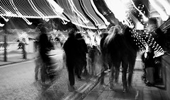 The drag into the fair! (livingsta) Tags: blur motionblur icm intentionalcameramovement blackandwhite bedford bedfordshire bw monochrome night nightphotography nightlife nightstreet streetlife streetphotography streetphoto street lights fairylights ghostly longexposure cameramovement drag fair fun festival festive celebrations people