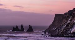 Silhouettes (katrin glaesmann) Tags: iceland island dyrhólaey reynisdrangar basaltseastacks unterwegsmiticelandtours photographyholidaywithicelandtours sunrise seascape silhouettes snow winter spray