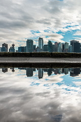 city reflections 🔃 (Sonika Arora 604) Tags: nikon nikonphotography nikonphotographer nikonphotographers nikond800 photography photo photographer explorebc explorecanada explorevancouver vancouver vancity britishcolumbia bc beautifulbc beautiful canada stanleypark stanleyparkseawall seawall city cityscape buildings towers condos architecture park water reflection puddle clouds sky blue