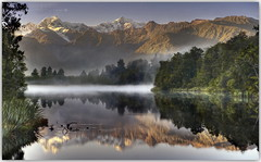 Truth is the torch that gleams through the fog without dispelling it (PhotoArt Images) Tags: lakematheson newzealand nzsouthisland photoartimages mountains misty reflections sunrise