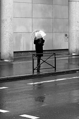 Under the bell (pascalcolin1) Tags: paris13 femme woman pluie rain parapluie umbrella cloche bell photoderue streetview urbanarte noiretblanc blackandwhite photopascalcolin canon50mm 50mm canon
