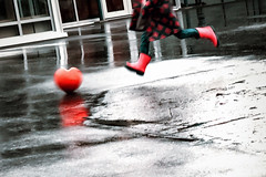 Little Heartbreaker : )) (Natalia Medd) Tags: happyvalentinesday heart girl playing redrubberboots running kicking reflection rain february14th wet street fun funny happy valentines red iphone