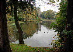 Autumn by the lake at Gawsworth Hall, Cheshire (alanhitchcock49) Tags: gawsworth hall lake cheshire autumn colours october 2017 wet reflections church of st james the great mary fitton samuel maggoty johnson