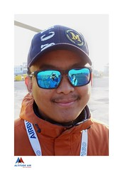 Mt. Everest Helicopter Expedition (posterboy2007) Tags: nepali pilot kathmandu reflections blue sony sunglasses