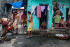 Workers colony (SaumalyaGhosh.com) Tags: workers colony morning kolkata india calcutta color bathing bath colors street streetphotography eat eating
