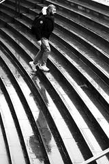 On the curved steps (pascalcolin1) Tags: paris opéra homme man marches steps courbé curved pluie rain reflets reflection photoderue streetview urbanarte noiretblanc blackandwhite photopascalcolin canon50mm 50mm canon