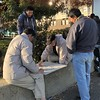 The Board Game--Xiangqi (Melinda Stuart) Tags: men asian board game pieces afternoon sun bench city urban chinatown jeans spectators four oakland ca tradition park sidewalk chinese jackets friends together interest focus madisonpark humaninterest encounter china xiangqi chess