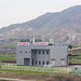 Reunification train station with a slogan about Kim Il-sung at the top, North Hwanghae Province, Kaesong, North Korea