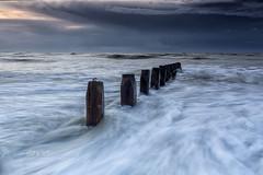 Turmoil (Through Bri`s Lens) Tags: sunrise sussex waves groynes forboding drama skies sky sea brianspicer lee09softgrad canon5dmk3 canon1635f4