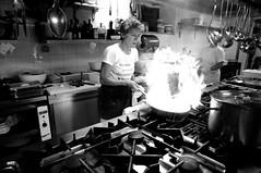 in cucina 1 (luporosso) Tags: nikon nikonitalia nikonclubit cucina kitchen fuoco fire flambé cuoco chef fornelli cookers bianconero biancoenero blackandwhite blackwhite blancoynegro bn bnw bw