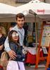 Porto riverbank (Marian Pollock) Tags: portugal couple porto riverbank sunglasses boy girl umbrella europe street