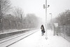 Stranded (Andrew Hocking Photography) Tags: penryn penrynstation snow trainstation stranded minimal street bleak uk gb cornwall landscape outdoor winter snowy tracks train gwr greatwesternrailway lonefigure figure commuter weather