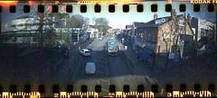 Cheadle Hulme (4) (benmet47) Tags: bus transport mct manchestercommunitytransport optare versa optareversa yj11enr street shops film lomo lomography sprocketrocket lomographysprocketrocket canoscan9000f