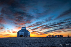 Farmland Sunset_186776 (rjmonner) Tags: iowa farmland winter corncrib farm rural field harvested fallow sunset relic history agricultural agronomic antique remnant vanishing blue red orange dusk hdr nikon midwest cornbelt harvest corn crop fade past rare farmstead barn clouds dilapidated neglected battered crumbling decaying time timeworn reclaim color colorful travel stationary