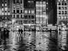Rainy Night in Union Square (deepaqua) Tags: night building window puddle street truck unionsquare storefront drizzle auto sidewalk nyc umbrella blackandwhite silhouette rain reflection mcdonalds