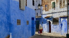 Living in the Blue City (Alex L'aventurier,) Tags: chefchaouen maroc morocco street medina rue blue bleu bluecity urban urbain decay woman femme candid person shadow ombre houses maisons details doors portes architecture moroccan fenêtres windows