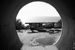 The Light At The End Of The Tunnel In Big Sur, California, USA (thedot_ru) Tags: tunnel bigsur travel adventure wanderlust sign puddle sky blackandwhite bw canon5d 2014
