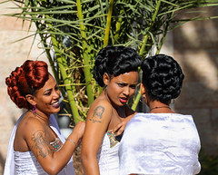Would you be delighted to be tattooed on their arm? (ybiberman) Tags: israel jerusalem ethiopianchurch ethiopiancathedral wedding women tattoo jesuschrist jesus hairdress portrait candid streetphotography white people