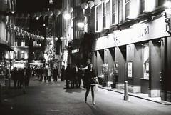 London (goodfella2459) Tags: nikon f4 af nikkor 50mm f14d lens ilford delta 400 35mm blackandwhite film analog night london city buildings people pedestrians lights bwfp manilovefilm