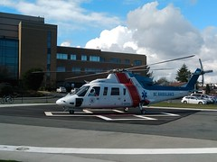 IMG_20180301_132001 (kevin_in_bc) Tags: clouds sky helicopter ambulance cancercentre hospital fence bicycle