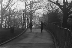 Women Walking Backwards, Sunset Park, Brooklyn (josephkrings) Tags: 1stavenue brooklyn greenwoodcemetery ilfordhp5 newyork nikkor28105mm13545 nikonn70 sunsetpark blackandwhite excercise park