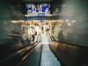 Downstairs - Cologne Main Station (Sebastian Bayer) Tags: köln hauptbahnhof bahnhof dynamik langzeitbelichtung laowa street perspektive reisen stadt bewegung ausflug menschen rolltreppe lenstagger