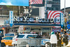 Times Square (MikePScott) Tags: architecturalfeatures banner buildings builtenvironment camera clouds featureslandmarks flag logo newyork newyorkcity nikon28300mmf3556 nikond800 people police policestation sign sky taxi timessquare transport usa