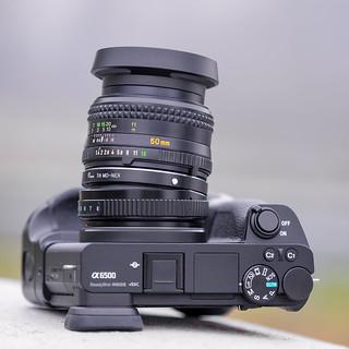 Minolta MD Rokkor 50mm ƒ/1.4 with tilt adapter seen by Minolta AF 70~210mm ƒ/4 'beercan' on SONY ⍺7II