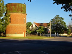 Swan Hill. The second brick water tower built in McCallum Street. This simpler tower was built in 1902. Beyond is Elwood House built 1930. (denisbin) Tags: swanhill rivermurray paddleboat steamer riverboat water towertankschoolcatholic schoolstate schoolbanknationalbank elwoodhouse mccallum