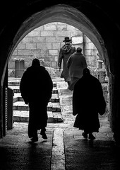 Passing (Topolino70) Tags: canon600d jew priest monk arch gateway street man people stone wall israel