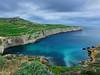 Fomm ir-Rih (Maximus DiFermo) Tags: maximus difermo mgarr malta bay nw north west sea clouds waterfall pentax overcast