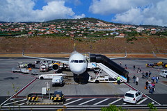 At the airport (Steenjep) Tags: madeira portugal ferie holiday urlaub funchalairport airplane airfield runway truck landscape sky thomascookairlines thomascook airbus a321 oytcd