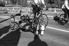 Wheelchair Athlete (burnt dirt) Tags: wheelchair bicycle bike athlete competition helmet uniform marathon halfmarathon 5k course race racer pedal wheel flag road street amputee prosthetic sunglasses glasses downtown town city bw blackandwhite fujifilm camera metro station busstation trainstation hero military xt1 streetphotography urban candid portrait documentary laugh smile winner medal sport vehicle outdoor people person abb5k houston texas houstonmarathon houstonhalfmarathon chevron man woman crank gloves sunny cold