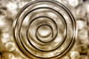 Abstract Gold Swirl art with Bokeh.jpg (mraderstorf) Tags: nikon105mmf28 bokeh pattern shiny art reflective swirl abstract nikond700 gold brown circle metallic metal macro