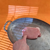 Pork meat. (annick vanderschelden) Tags: pork meat slices culinary domestic pic suscrofadomesticus consumed raw cooking fat texture dietary food pig preparedmeat nutrition wood board orange table