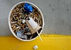 An Encounter With a Bucket Full of Butts (ricko) Tags: bucket cigarettebutts cup glasses frames curb pavement paperwad 59365 2018 nasty