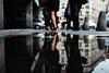 candy wrapper (ewitsoe) Tags: fugi fugifilm x100f reflection reflect city legs students summe rstreet urban cityscape candywrapper puddle summerday warm pedestrians cmmuterswalking feet poznan poalnd ewitsoe