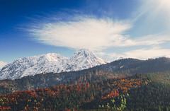 Giewont (kubaszymik) Tags: peak tatry giewont snow trees colors autumn fall summit valley hills rocks sky sun clouds cross poland zakopane kościelisko