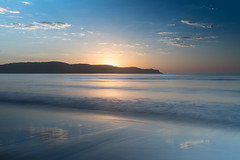 Smooth Sunrise Seascape with Cloud Reflections (Merrillie) Tags: daybreak sunrise headland australia reflections clouds newsouthwales smooth uminabeach sun blue morning ocean sea umina landscape earlymorning nsw sky seascape waterscape nature water dawn